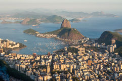 Sunset panorama over Rio de Janeiro, Brazil. Late evening view over Rio de Janeiro from the Christ the Redeemer statue on top of Corcovado mountain. Favela in Royalty Free Stock Photo