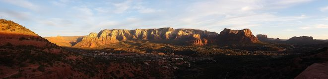 Sunset panorama of red sandstone formations in Sedona. A sunset panorama of the red sandstone formations in Sedona Arizona Stock Photography