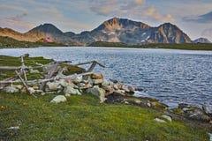 Sunset panorama of Tevno Lake and Kamenitsa peak, Pirin mountain, Bulgaria Royalty Free Stock Photos