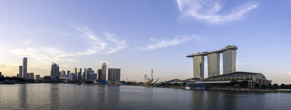 Sunset panorama view of Singapore skyline over a clear blue sky Royalty Free Stock Images