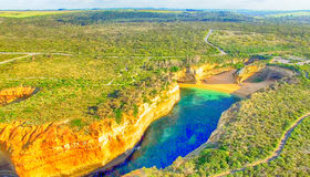 Sunset panoramic aerial view of Loch Ard Gorge and Island Arch,. Great Ocean Road - Australia Stock Images