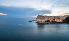 Sunset, panoramic view on Ancient Aragonese Castle in Taranto. royalty free stock photo