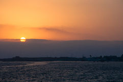 Sunset in Paphos. Overviweing castle Stock Image