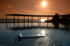Sunset in Paradise. Sun sets over an infinity pool along the coast of the Baja Mexicio stock photos