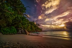 Sunset on paradise beach at anse georgette, praslin, seychelles 4. Picturesque sunset on dream beach at anse georgette on praslin on the seychelles. A big royalty free stock photos