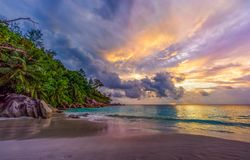 Sunset on paradise beach at anse georgette, praslin, seychelles 11. Picturesque sunset on dream beach at anse georgette on praslin on the seychelles. A big royalty free stock photography