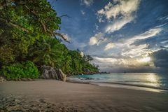 Sunset on paradise beach at anse georgette, praslin, seychelles 4. Picturesque sunset on dream beach at anse georgette on praslin on the seychelles. A big stock photos
