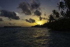 Sunset in Paradise. A beautiful sunset at the Maldives with view on a small island Stock Photos