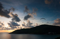 Sunset with paraglider in the sky Stock Photos