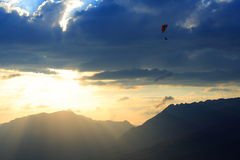 Sunset and paragliding Stock Images