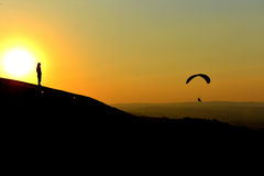 Sunset and paragliding.  Royalty Free Stock Image