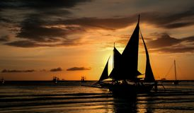 Sunset. Paraw sail boat is a traditional sail boat in visayaz region in phillipines Royalty Free Stock Photography