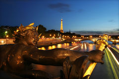 Sunset in Paris #7. Eiffel tower and Seine river in Paris at night Stock Photos
