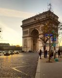 The sunset of paris with L& x27;Arc de Triomphe, Paris, France. View of the sunset of paris and the landmark of victory of napoleon Stock Photos