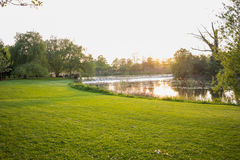 Sunset in a park over looking a lake Stock Images