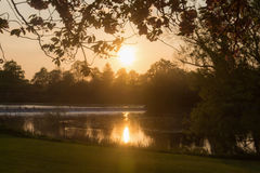Sunset in a park over looking a lake Royalty Free Stock Image
