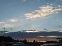 Sunset in a parking lot stock image