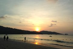Sunset on Patong beach, reflected in the sea, against the backdrop of the mountains, Thailand stock images