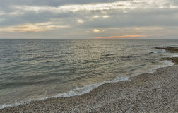 Sunset pebble beach in Croatia Stock Photo