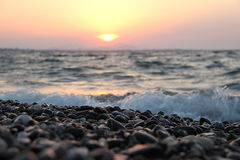 Sunset on the pebbles beach Royalty Free Stock Images