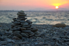 Sunset on the pebbles beach Royalty Free Stock Photos