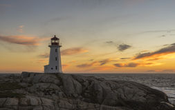 Sunset at Peggy's Cove Lighthouse. A crisp autum day comes to a close at the lighthpouse at Peggy's Point, Nova Scotia royalty free stock image