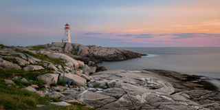 Peggy`s Point Lighthouse at sunset. Sunset at Peggy`s Point, or Peggy`s Cove, Lighthouse at Peggy`s Cove, Nova Scotia stock image
