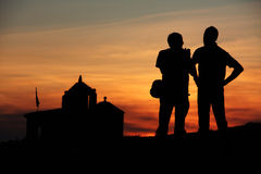 Sunset people. Two people during sunset hour, the teacher teaching the student Stock Images