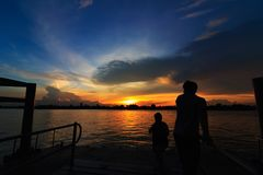 Sunset  with people of silhouette. Sunset  at  port  of Bangkok  near rivere with  people  silhouette Stock Photo