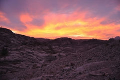 Sunset in Petra, Wadi Musa. Sunset over the hill in famous tourist destination Petra, Wadi Musa, Jordan Stock Photography