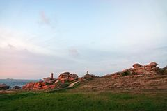 Sunset at Pink Granite coast in Brittany. Sunset at Phare de Men Ruz. Côte de Granit Rose is one of the most beautiful stretches of Brittany's stock photography