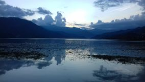 Sunset in phewa lake Stock Images