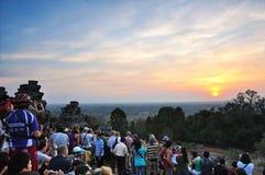Sunset at Phnom Bakheng, Angkor. Travelers was waiting for the sunset at Phnom Bakheng, Angkor, Cambodia Stock Images