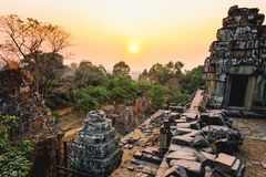 Sunset of Phnom Bakheng, one of the ruined temples of ancient Cambodia. Sunset of Phnom Bakheng, one of the ruined temples of ancient Cambodia in Siem Reap Royalty Free Stock Images