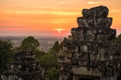 Sunset at Phnom Bakheng Temple, Angkor Wat, Cambodia. Sunset at Phnom Bakheng Temple in Angkor Wat Complex in Cambodia Stock Photos