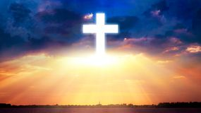 Sunset photo . light about the sky . landscape at sunset . Glowing cross in sky . Happy Easter. Light from sky . Religion background . Paradise heaven . Light stock photography