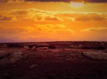 Sunset. Photo manipulation. Sun. Sunset with photo manipulation. Rocks royalty free stock image