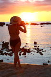 Sunset photograph. Enjoying the sunshine and the beach with my tablet Stock Image