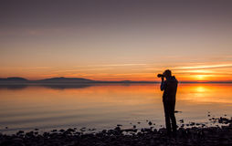 Sunset. A photographer in the sunset Stock Image