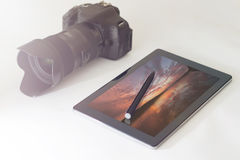 Sunset photography concept, DSLR, digital tablet. Sunset photography Stock Image