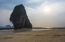 Sunset at Phra-nang cave beach. Phra-nang cave beach locate near east and west railay bay beach. It's paradise beach for tourism diving and sunbathing on Royalty Free Stock Image