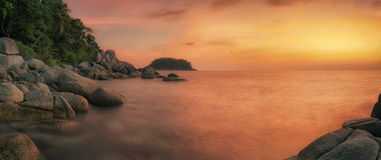 Sunset in phuket beach with rock Royalty Free Stock Photography