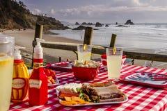 Sunset Picnic on Ocean Overlook Stock Photo