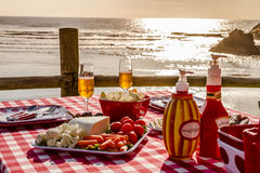 Sunset Picnic on Ocean Overlook Stock Images
