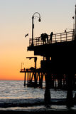 Sunset by the pier Royalty Free Stock Photos