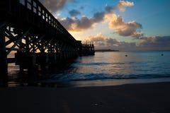 Sunset pier. A pier in Punta del Este Stock Photos