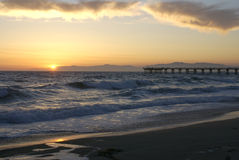 Sunset at Pier. Sun tips over the mountain from Hermosa Beach Royalty Free Stock Photos