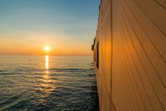 Sunset at the pier. In Aberystwyth, Ceredigion, Dyfed, Wales, UK Royalty Free Stock Photo