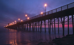 Sunset at the Pier. Sunset fades and the pier lights come on Royalty Free Stock Photo