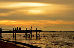 Sunset at the pier. With friends Royalty Free Stock Image